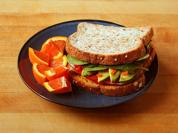 Sandwich on sprouted whole grain bread (spinach, avocado, grated ...