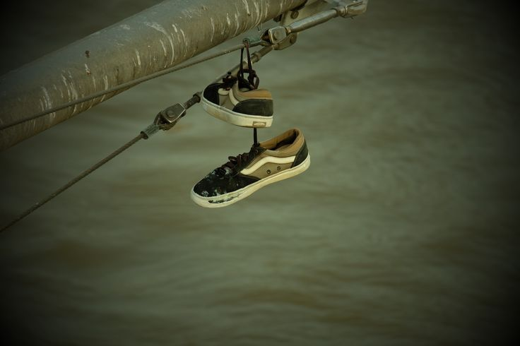 A random pair of @vans dangling from a bridge in Frankfurt am Main.  #Vans #Shoes #Bridge #Frankfurt #Main