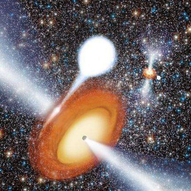 An artist's conception of black holes feeding on matter from companion stars and sending out bright jets into the space within a globular cluster.