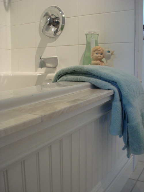 Bath - use the same cultured marble as the counter top.  Stain the bead board to match the cabinets.
