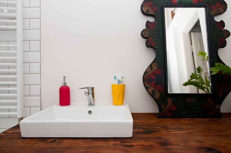 subway tiles, reclaimed wood countertop and traditional painted mirror in our bathroom