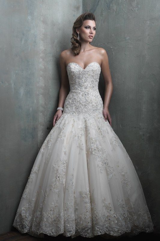C301 Allure Couture Bridal Gown - Beaded lace appliqué and scattered sequins cover the skirt and dropped waist bodice, catching the light in this English net bridal gown.