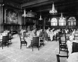 This is an undated photo of the dining room at the Alexandria Hotel, site of a brief April 1920 fistfight between Louis B. Mayer and Charlie Chaplin.  Chaplin and Mayer reportedly at odds over Chaplin's divorce from Mildred Chaplin, under contract to Mayer at the time.  Chaplin's first meeting with Jackie Coogan, in the summer of 1919, also reportedly took place at the Alexandria Hotel.  Photo accessed at http://historylosangeles.blogspot.com/2010_10_01_archive.html