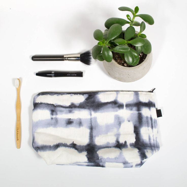 """Travel kit - Shibori  Makeup bag with waterproof interior, perfect for all your cosmetics, flat iron and all your toiletries during your small or big trip  Exterior fabric (100% cotton) Waterproof nylon interior  Dimension: 12-1/2 """" x 7-1/2""""h Base 4"""" large Zipper 12"""""""