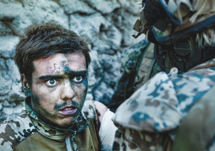 Wounded Danish soldier moments after close combat (Afghanistan 2010).