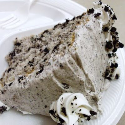 Cookies and Cream Cake Ingredients: Cake 1 Box white cake mix Eggs, water and oil as called for on the box ~OR your favorite white cake recipe 15 Oreos, crushed Frosting 1 (8 oz) package cream cheese, softened 1 (16 oz) box powdered sugar 1 (8 oz) container Cool whip, room temperature 15 Oreos, crushed ¼ tsp. pure vanilla extract