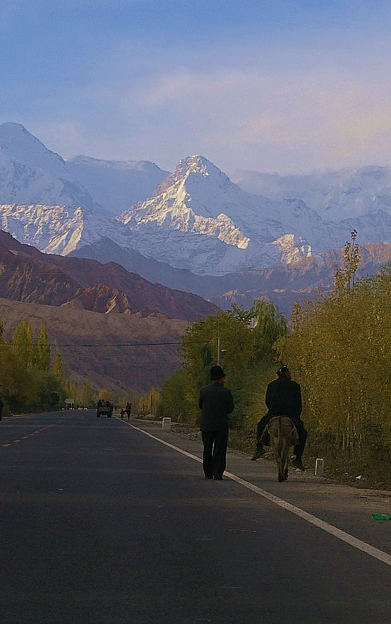 The people of villages near Kashgar make their way to market early in the morning along the Karakoram highway.