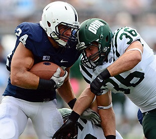 #OhioUniversity scores 21 unanswered pts to beat Penn State in Happy Valley 24-14. After Ohio beat Michigan & very nearly beat North Carolina in 2012 NCAA Tournament, the football team displayed some magic of its own in beating favored Penn State on its own turf.  Here, Penn State's Derek Day (24) is tackled by Ohio's Ben Russell. (Presswire)