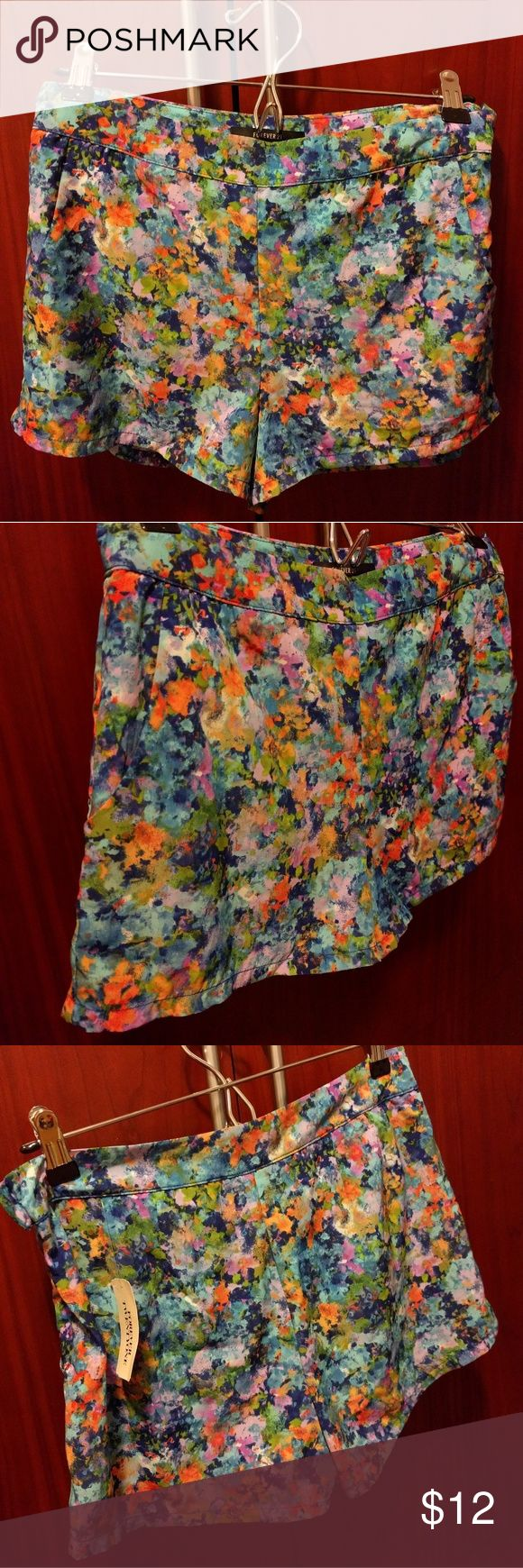 NWT Forever 21 watercolor print dressy shorts NEW WITH TAG - NEVER WORN  100% polyester  Really gorgeous water color abstract print  Loved this when I got it but it didn't fit me  Material does not stretch  I would suggest getting this if u fit a small....  Has a lining so it's not see through Forever 21 Shorts