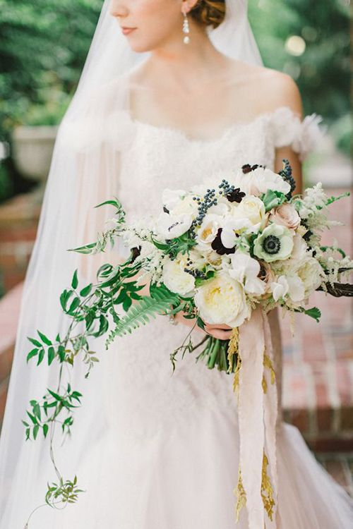 An elegant, black and white wedding bouquet with anemones | Brides.com