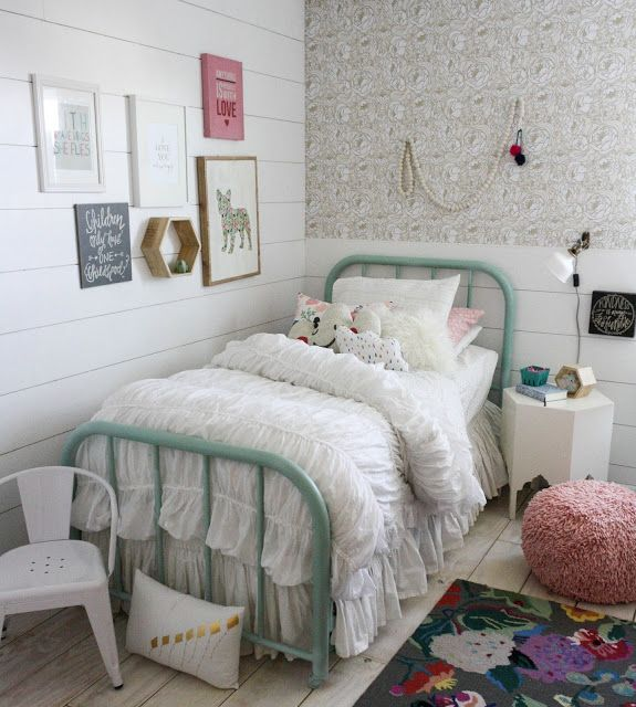 So many unique ideas for a girls bedroom. Wallpaper and a funky rug are the statement pieces.