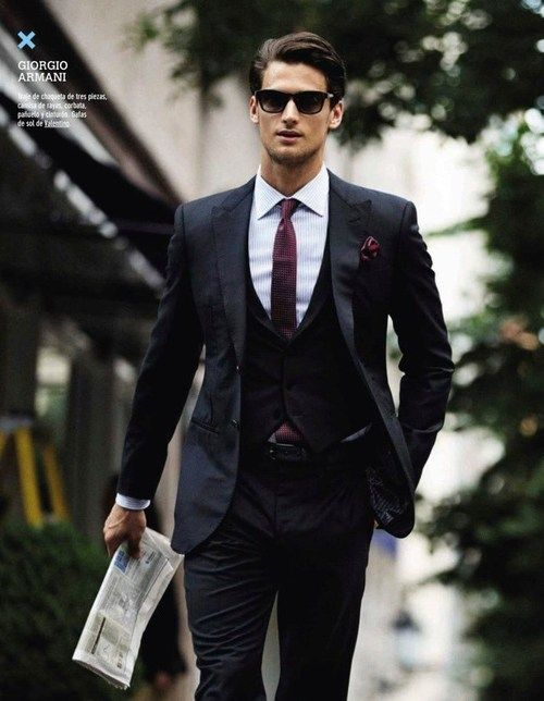 A three piece suit is a sleek look. Well tailored, slim fit, dark colours  with crisp white shirt. The burgundy tie and pocket square here would look  ...