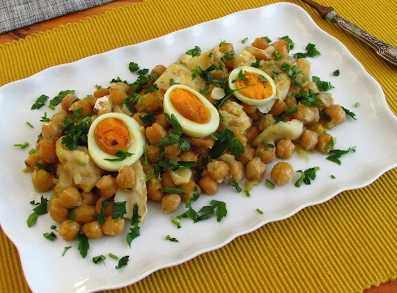 Cod with chickpeas in the oven   Food From Portugal. Delicious recipe of cod with chickpeas seasoned with pepper, wrapped in a sautéed of olive oil, onion and garlics, that goes in the oven garnished with boiled eggs cut into round slices and sprinkled with chopped parsley. http://www.foodfromportugal.com/recipe/cod-chickpeas-oven/