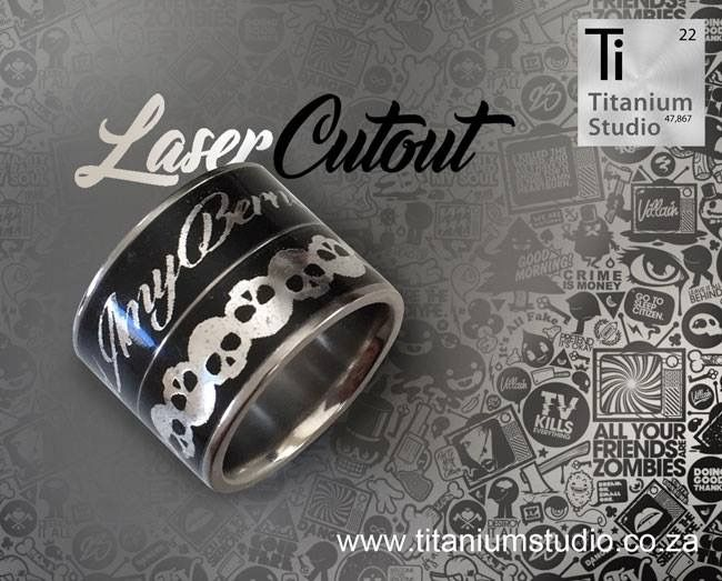 Black titanium wedding ring with skull cutout.