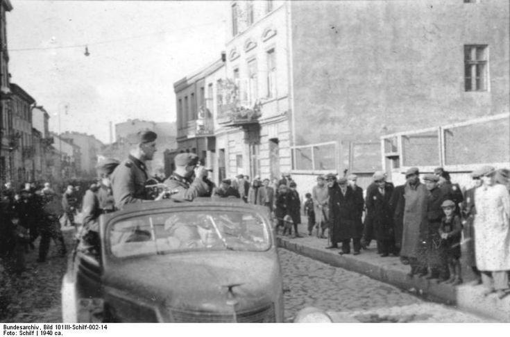 """Litzmannstadt (Lotz) ghetto, Poland, 1940: The photographers are photographed. Members of a Waffen SS propaganda company are caught on film while photographing ghetto people by army photographer Schilf, spring 1940. German propaganda units visited ghettos regularly to take pictures of record, some of which were published as part of propaganda drives to show how """"well"""" Jews lived in these crowded, filthy enclosures."""