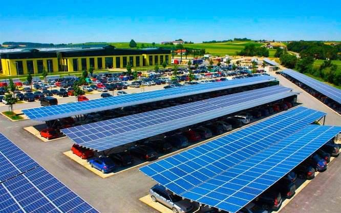 Every parking lot ought to look like this! — Shades the cars while producing free energy. Germany has created over 500,000 new jobs by pushing hard into solar and wind energy - providing incentives for everyone to install and as a result, they will be able to move forward with their plans to shut down all their nuclear power plants in the next decade.