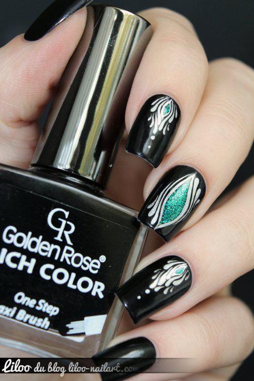 Really pretty amorphous yet symmetrical nail art - metallic silver, black, color pop