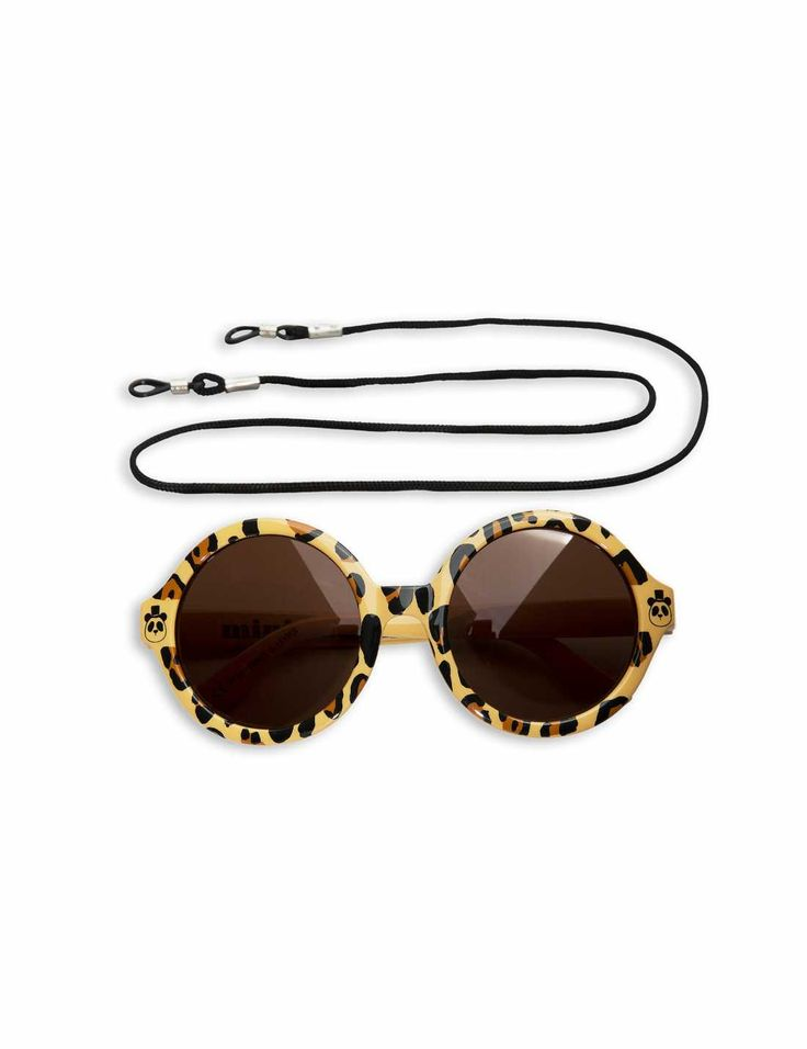 Leopard-printed sunglasses with round frames, brown lenses and Mini Rodini's classic panda printed on the frames.