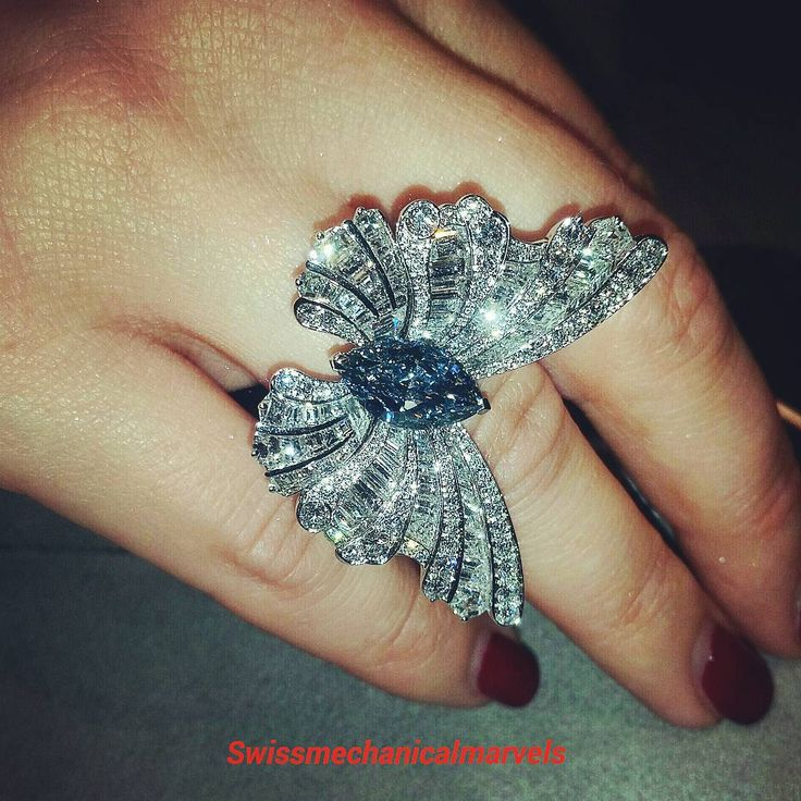 Diamond butterfly ring with an amazing vivid blue diamond over 3 carats! $7,800,000