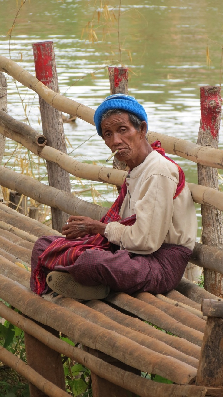 Burmese man smokes cheroot while contemplating the world #burma