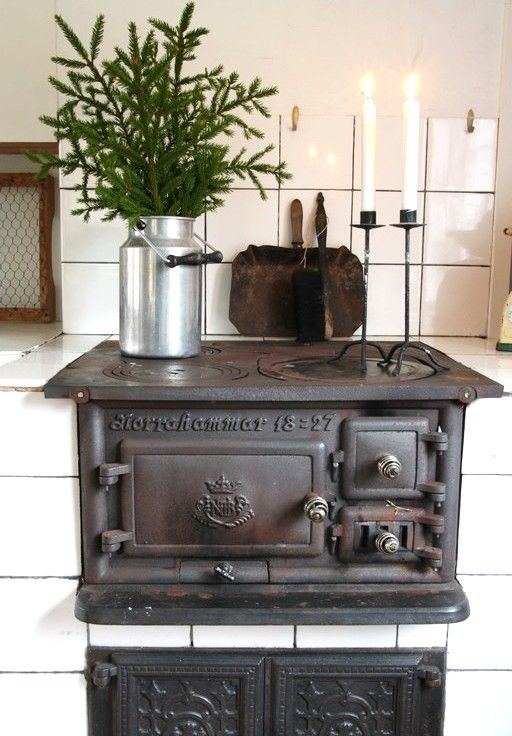 the heart of any home is its kitchen and this stove is classic.  I love the two candlesticks burning.