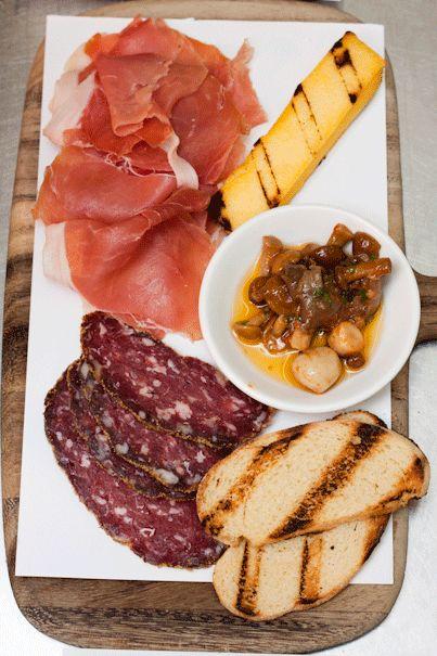 ANTIPASTO FRIULANO - Freshly sliced San Daniele prosciutto & Petuccia salumi, served with grilled yellow polenta.
