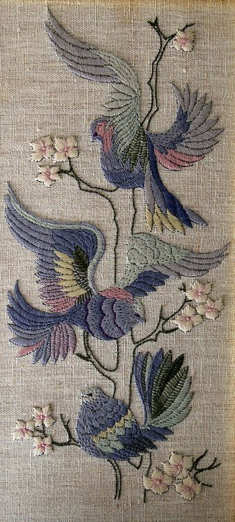 Panel with wool embroidered birds.