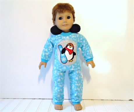 Christmas holiday pajamas set turquoise blue with white snowballs and a penguin with a snowboard print applique. The applique is machine stitched on.  The flannel pajama pants have pulled cotton knit cuffs and waistband.  The flannel shirt has a pulled cotton knit collar and cuffs and closes in the back with soft hook and loop strips.  The black fleece neck pillow is stuffed with hypo-allergenic fiber fill.  *As always, I give a shipping discount on multiple listing purchases. Handmade by me…