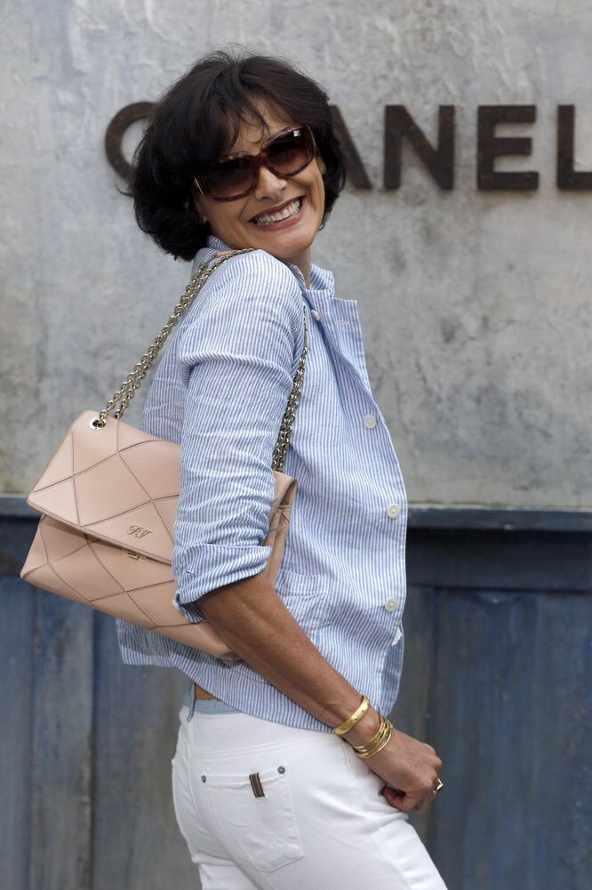 Carrying a Roger Vivier handbag prior to the Chanel Haute Couture Fall-Winter 2013/2014 collection shows at the Grand Palais in Paris.(photo- Francois Guillot/AFP/Getty Images)