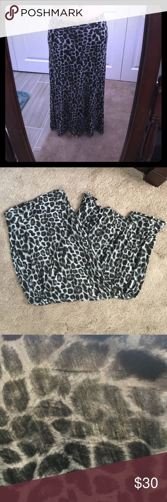 Leopard maxi skirt Wet seal size small leopard maxi skirt. Flowy. Super cute. It is sheer as tried to depict in the last photo (it was held up to direct sunlight to try and show the sheerness of it) wearing it I don't think it is as bad but it is still sheer. Wet Seal Skirts Maxi