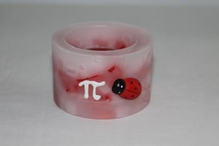 """https://flic.kr/p/NmuaZv   MARBLE CENTREPIECE – MADE OF WAX   Round marble – red, pink and white colours – centrepiece made of wax, decorated with a plastic ladybug and a white freehand """"pi"""" in 3D; with a tealight inside; 100% natural essential oil with lavender fragrance. Diameter: 80 mm. It's a perfect favour or decoration for your Mathematics degree!  Handmade.  Read more:   www.ilmiomondoincera.com"""