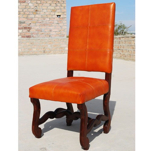 The Retro Gothic Orange Leather Chair Merges Sleek Square Back And Seat With Intricately Carved Legs A Mahogany Stain