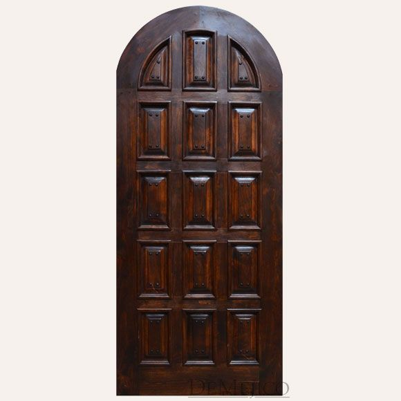 Mediterranean interior doors, the Monastery Door is a made from solid knotty alder wood. Showcasing a full arched top, multi-panel design, and iron clavos.