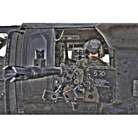 HDR image of a UH-60 Black Hawk door gunner manning a M240 machine gun Canvas Art - Terry MooreStocktrek Images (35 x 23)