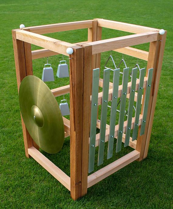 The ultimate outdoor music experience: our full cube music station made out of naturally rot resistant cedar. Let your imagination play! This one of a kind outdoor music station features a large xylophone, triangles, cowbells, and a cymbal. Also included are three mallets, three