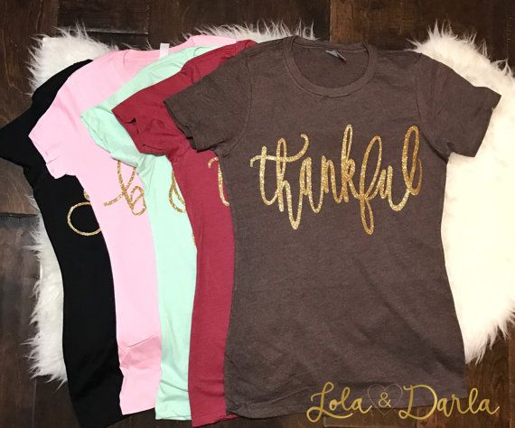 Thankful womens t shirt Thankful is printed in gorgeous golden sparkle! Pictures do not do the sparkle justice! THESE DO RUN A SIZE SMALL! If you normally wear an x small, order a small! They are super comfy and the sparkle is amazing! Available on black or white t shirt. 60% ring-spun combed cotton/40% polyester  Production time is approximately 3-7 business days.  Machine wash cold inside out and tumble dry low.  Thanks for sparkling with Lola and Darla!  Please note: Because our items...