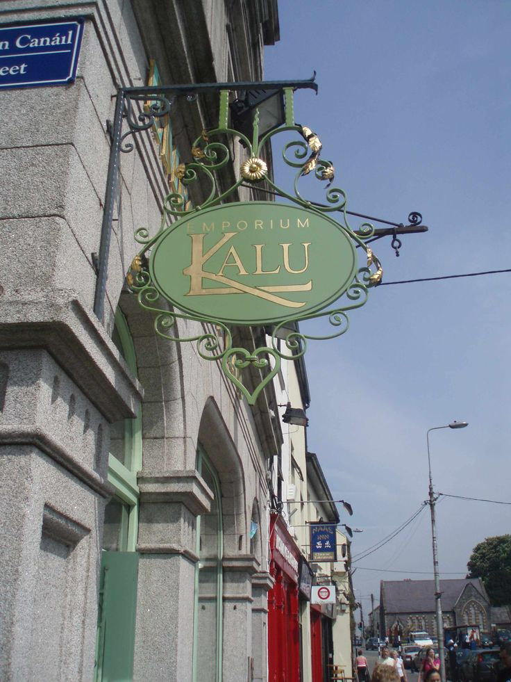 Hand painted hanging sign in Naas for Kalu ladies boutique. Note the gilded copper leaves attached to metal framework