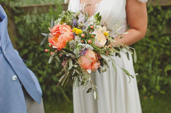 Coral peonies, hypericum, Juliet Roses, craspedia, olice, blue scabiosa, chincherinchee and lavender. Bridal bouquet. Oranges, yellows, greens, grey greens, corals.
