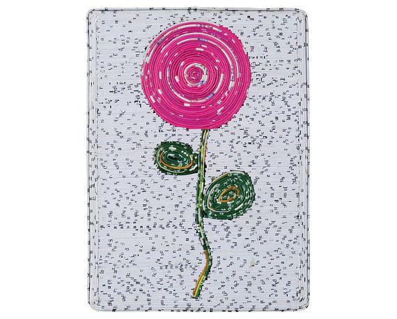 Imagen de pequeñas flores rosadas mediante reciclado papel
