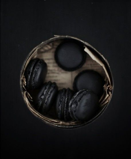 Just because I love macarons. How dramatic do they look! Just guessing here... liquorice?