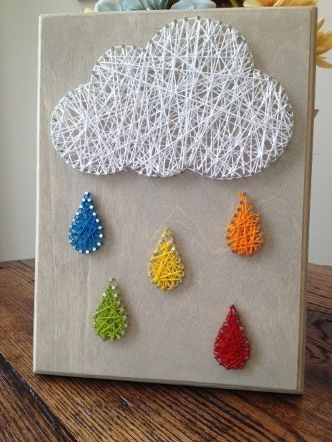 Rain Cloud Nail & String Art Simple & easy design, totally beautiful finished project! This would be good for one of my young nieces rooms. I especially like the different colors raindrops - this being Washington state, it would be really great if it could brighten up the idea of rain for them.