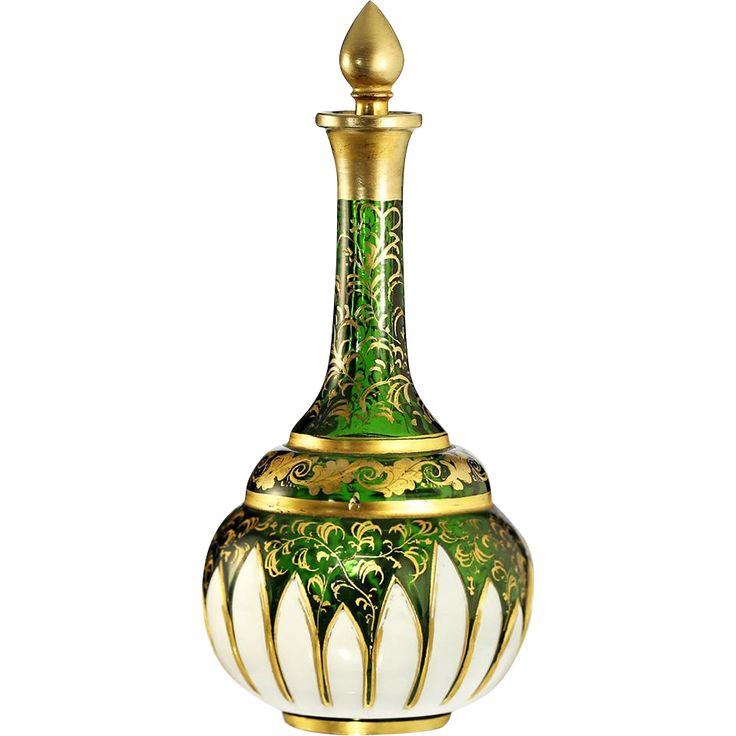 A fine shaft and gourd white over green glass scent bottle and conforming stopper. The bottle is masterfully hand decorated with gilt leaf sprays, the