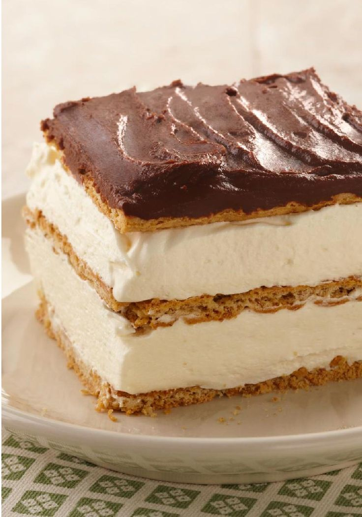 """Graham Cracker Éclair """"Cake"""" – This deliciously airy dessert treat includes graham cracker layers that become cake-like and soft from the pudding. Check out the recipe to see how easy this sweet no-bake dish is to make!"""