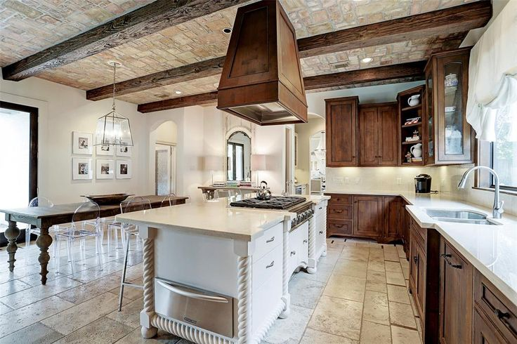 1212 Gray Moss. Gourmet kitchen with 6 burner gas stove top, built-in warming drawer, double stainless sink travertine floors, generous storage, wood beams and faux finished ceiling