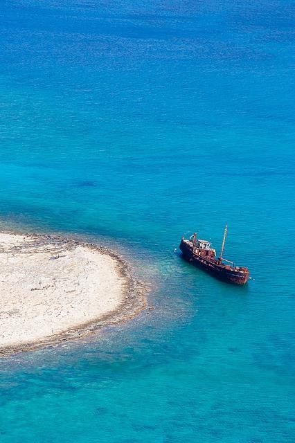 rusty shipwreck working as part of the scenery, Hania, Crete, Greece