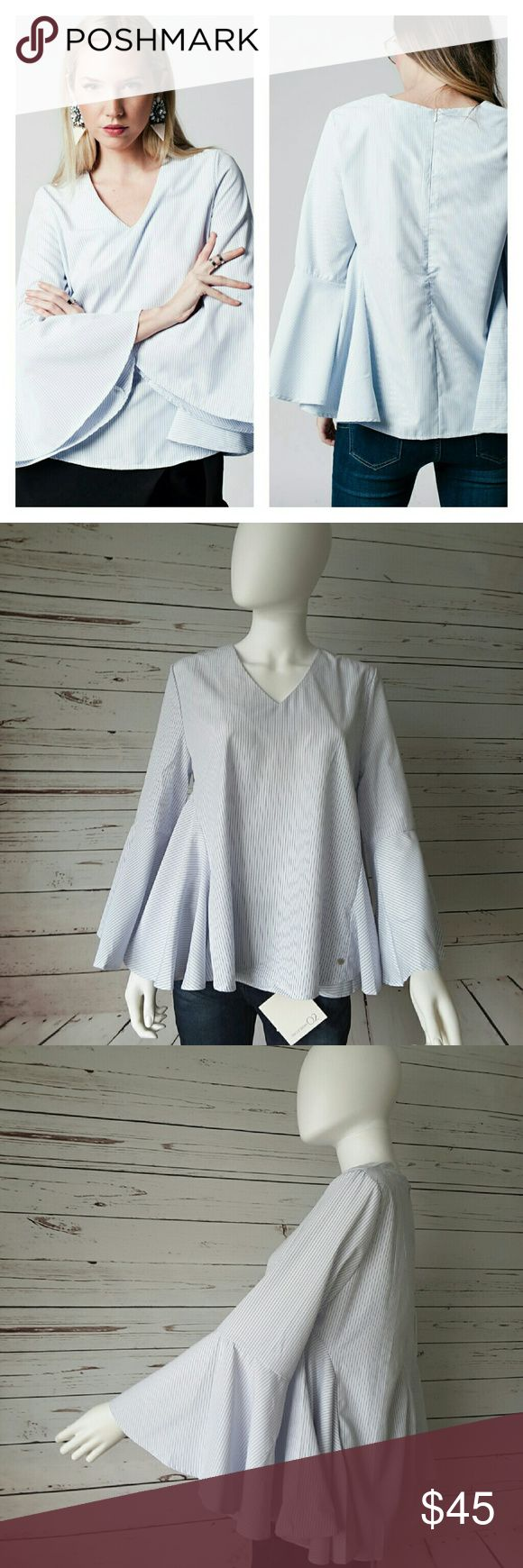 Striped FlounceTop This adorable, easy top has an all over pinstripe pattern, trumpet sleeves and side flounces. Zips in back. Fits size 8.  Price firm unless bundled, 15% off 3 or more, free shipping with 4+ Q2 Tops Blouses
