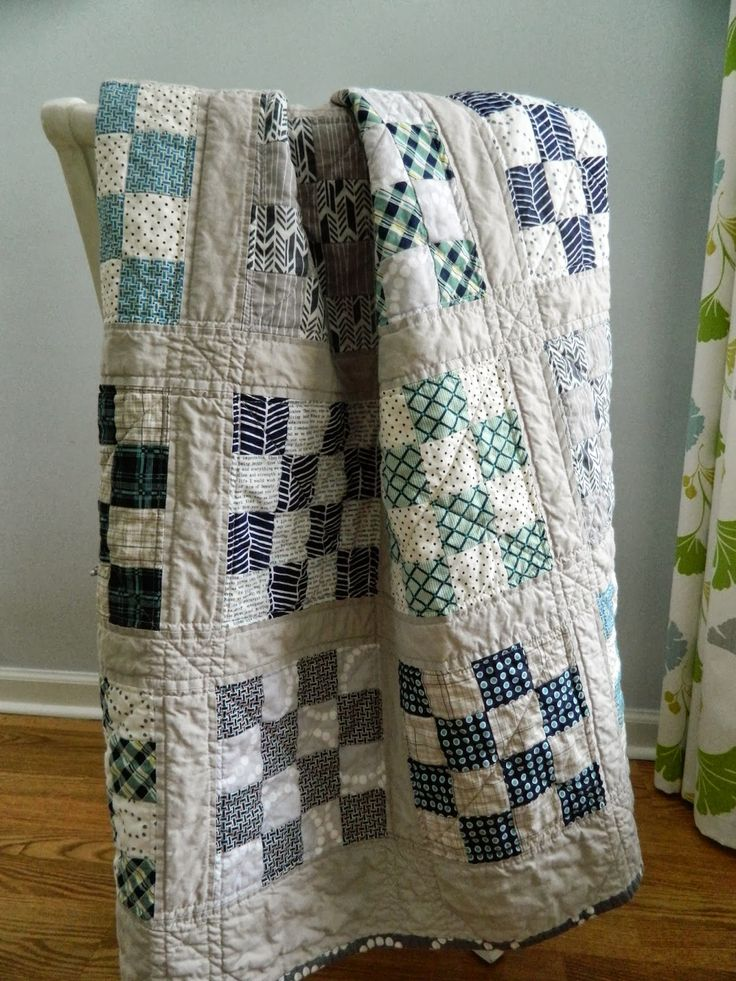 gray and navy quilts