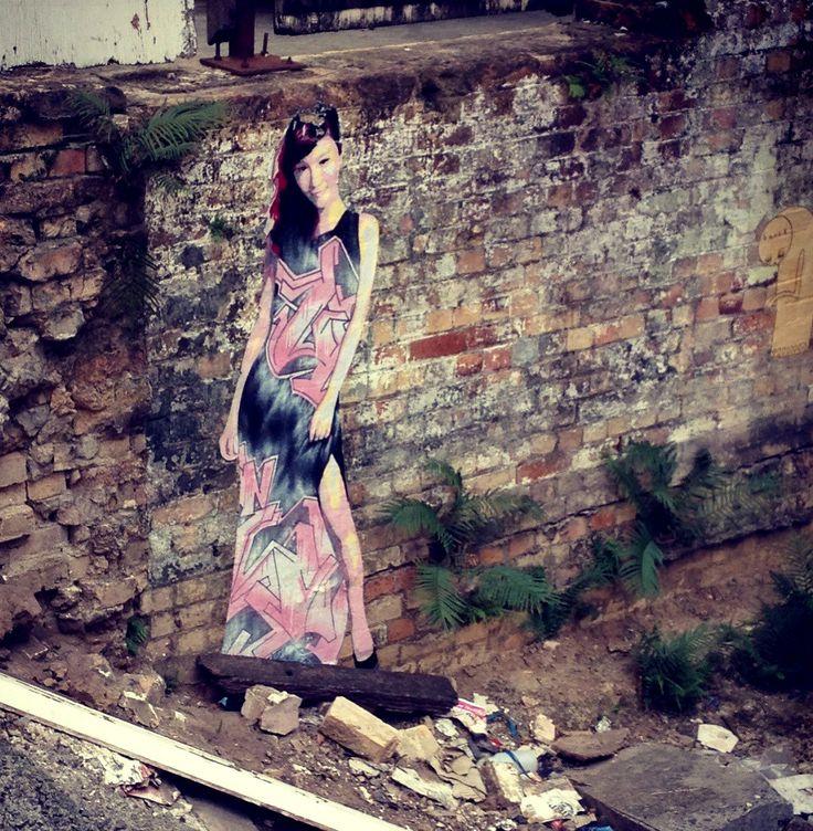 Laneway street art. 181 George Street, Brisbane. Paste up by Suki.