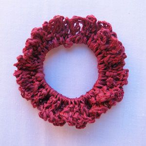 Lacy Hair scrunchie  I've made these for years.  This one is made with baby yarn.  I like to use chenille yarn.