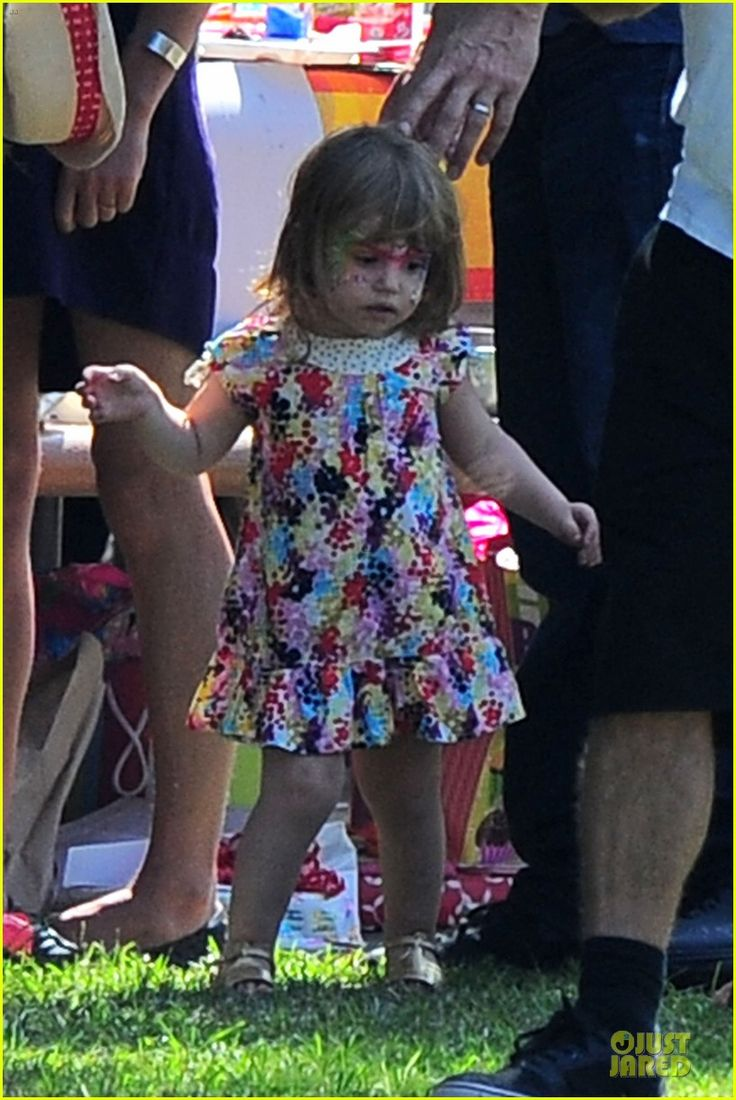 Isla Fisher and her husband Sacha Baron Cohen take their daughters Olive and Elula to a birthday celebration at the park on October 7, 2012